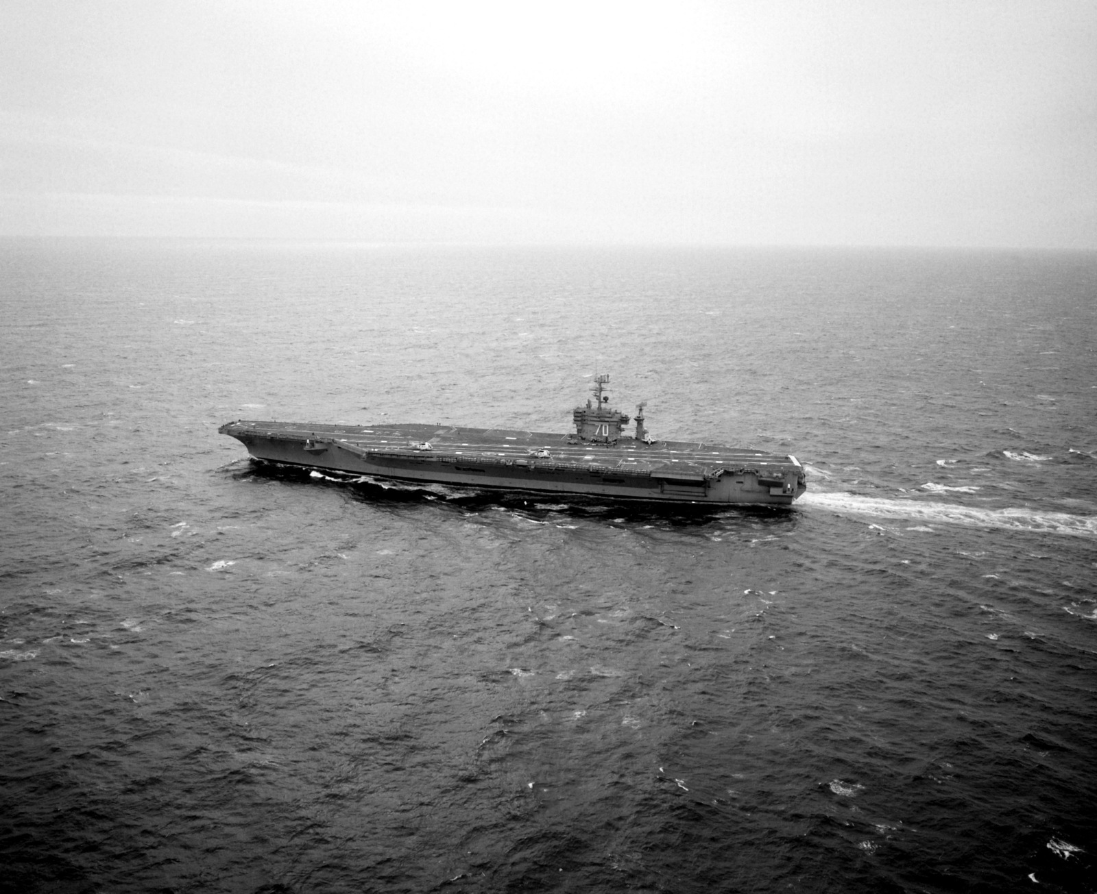 An aerial port beam view of the nuclear-powered aircraft carrier USS CARL VINSON (CVN-70) underway