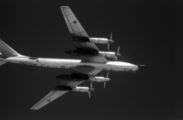 An air-to-air right underside view of a Soviet Tu-95 Bear aircraft about 42 miles off the Virginia coast. The Cuba-based Tu-95 aircraft just penetrated the U.S. air defense zone to aerially view sea trials of the new nuclear-powered aircraft carrier CARL VINSON (CVN-70)