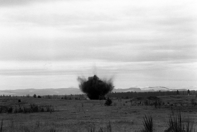 An M-15 anti-tank mine explodes after electronic detonation by members of Company A, 15th Engineer Battalion, during an exercise at Range 60