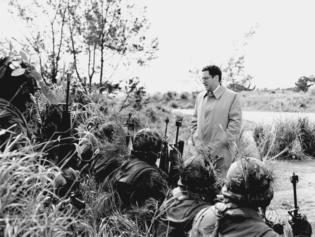 John S. Herrington, Assistant Secretary of the Navy, Manpower and Reserve Affairs, speaks with a group of Marines while on a visit to Okinawa