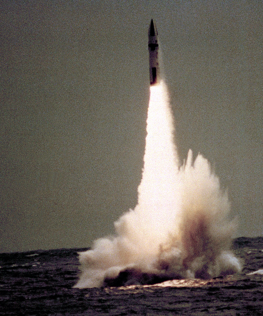 A Polaris missile is launched from the British nuclear-powered ballistic missile submarine HMS REOWN (S-26), not visible, off the coast of Cape Canaveral, Florida