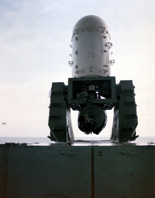 A rear view of the 3,000 rounds-per-minute Mark 15 (3X1) Phalanx weapons system. The 20mm Gattling gun hangs below the fire control radar/servo assembly (in white structure). Some 64 U.S. Navy ships will be armed with the weapons system