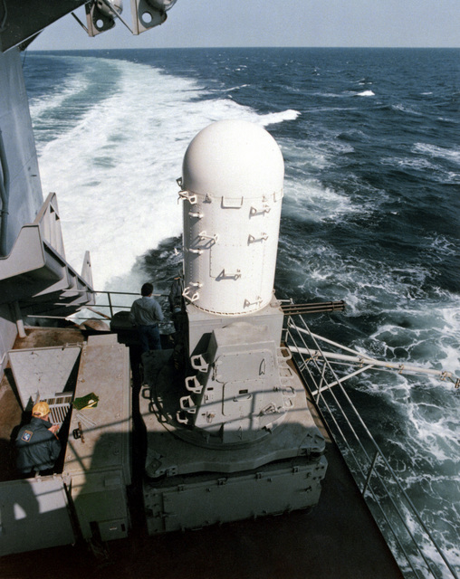 A right side view of one of three Mark 15 (3X1) Phalanx weapons systems installed aboard the aircraft carrier USS AMERICA (CV-66) in June 1980. The 3,000 rounds-per-minute system simultaneously measures the location of both target and projectiles in flight, and automatically corrects the fire control system