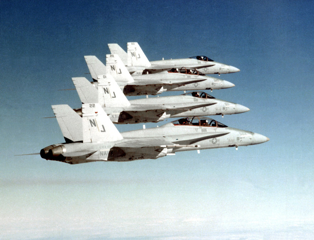 An air-to-air right side view of four F/A-18 Hornet aircraft from Fighter Attack Squadron 125 (VFA-125). The squadron is on a 23-day deployment from Naval Air Station, Lemoore, California. VFA-125 began flying the F/A-18 aircraft about 12 months ago. Squadron pilots have accumulated more than 1,500 hours in the aircraft so far