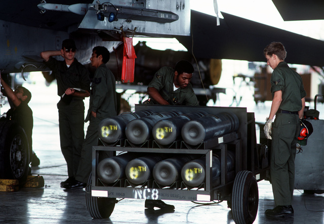 Members of the 833rd Organizational Maintenance Squadron perform maintenance on an F-15 Eagle aircraft