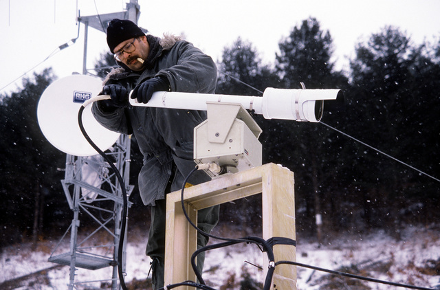 MSGT Frank Ander, 2146th Communication Squadron, plugs a camera into the power supply so the camera can be adjusted. The camera is being used to record ordnance test results on the Korean Tactical Range, located approximately 90 miles east of Osan Air Base, South Korea