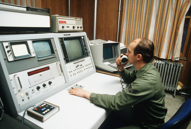 SGT Wayne Wolf, 2146th Communication Squadron, operates a television ordnance scoring system console on the Korean Tactical Range. The range is located approximately 90 miles east of Osan Air Base, Korea
