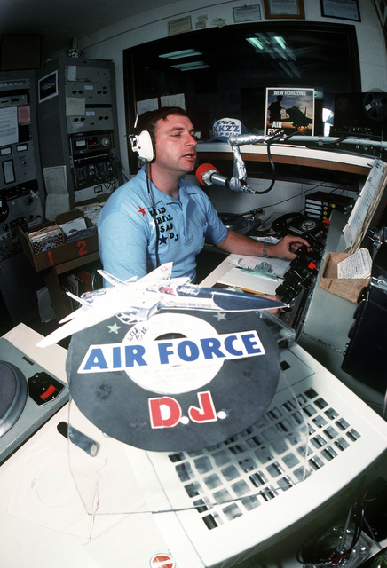 "TSGT William P. ""Wild Bill"" Henneberger, an Air Force recruiter, acts as a part time disk jockey with radio station KKZZ in order to increase his recruiting quota"