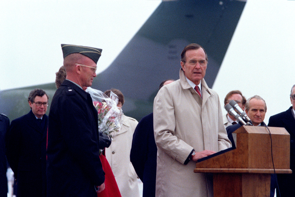 Army BGEN James L. Dozier is welcomed by Vice President George Bush in front of the crowd awaiting his arrival