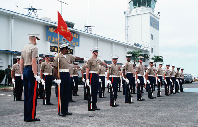 A US Marine Corps honor guard, armed with M16A1 rifles, prepare for an inspection by Assistant Secretary of the Navy John S. Herrington