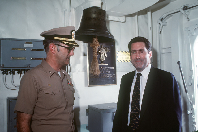 Assistant Secretary of the Navy John S. Herrington aboard the guided missile frigate USS WADSWORTH (FFG 9) with Commander John Ruff, ship's commanding officer