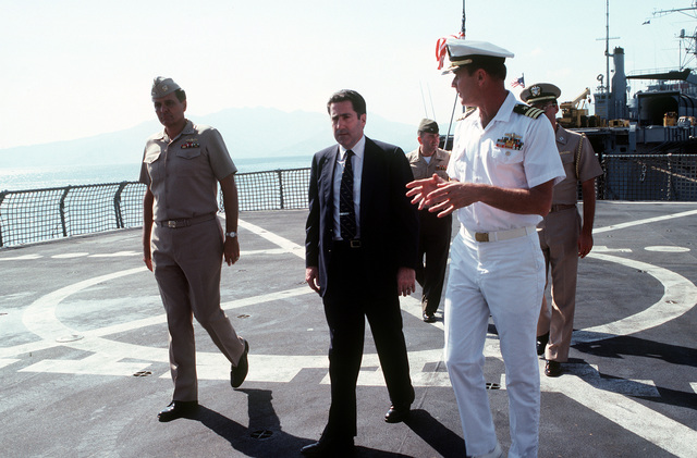 Assistant Secretary of the Navy John S. Herrington (center) on a ship's tour with CMDR. William R. Wheeler (right)