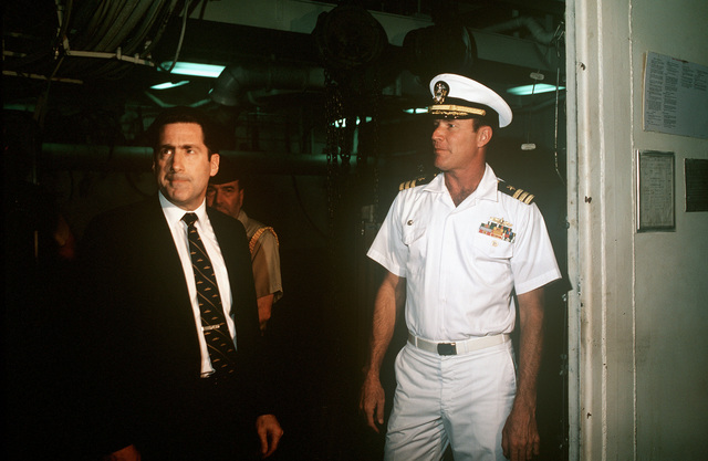 Assistant Secretary of the Navy John S. Herrington (center) on a ship's tour with Commander William R. Wheeler (right)