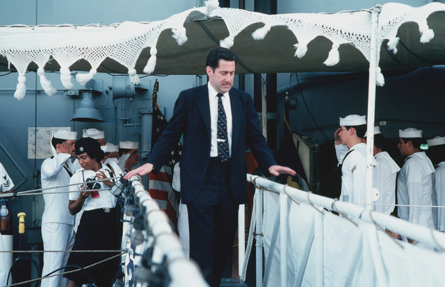 Assistant Secretary of the Navy John S. Herrington departs after a tour of the destroyer USS FIFE (DD 991)