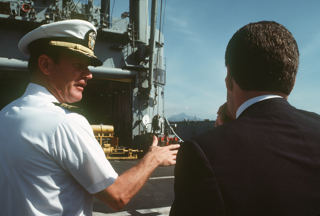 Assistant Secretary of the Navy John S. Herrington (right) and Commander William R. Wheeler, repair department head, tour the repair ship USS HECTOR (AR 7)