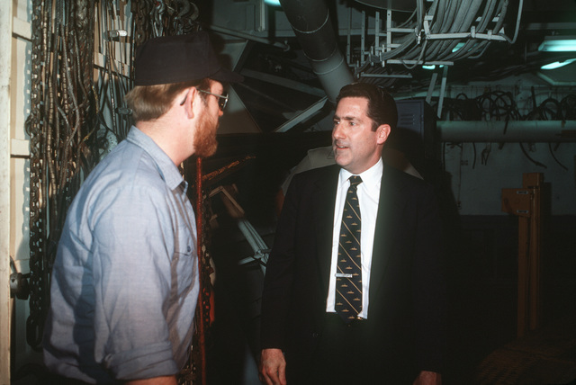 Assistant Secretary of the Navy John S. Herrington speaks to a sailor during a ship's tour