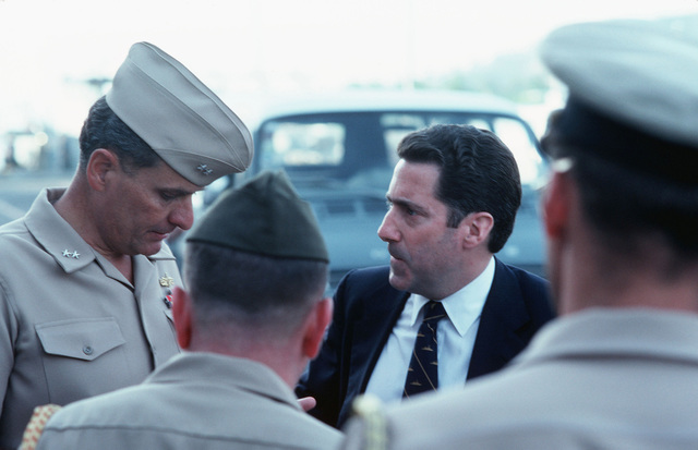 Assistant Secretary of the Navy John S. Herrington talks with Navy officers during an inspection tour