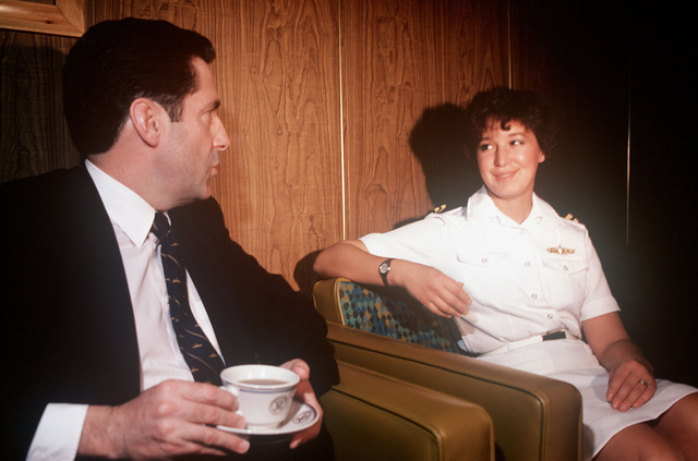 Assistant Secretary of the Navy John S. Herrington talks with the Lieutenant Karen Nichols, operations division department head, during a tour aboard the repair ship USS HECTOR (AR 7)