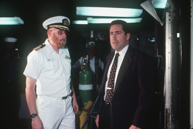 Assistant Secretary of the Navy John S. Herrington with a US Navy officer during a ship's tour