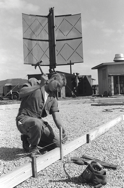 PFC Charles Isaacs from Marine Security Group 17 prepares the form for the new radar dome foundation