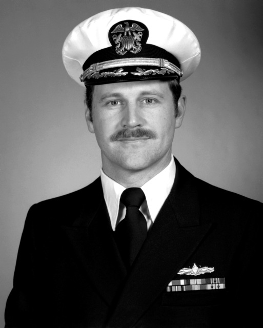 CDR Eric L. Washan, USN (covered)