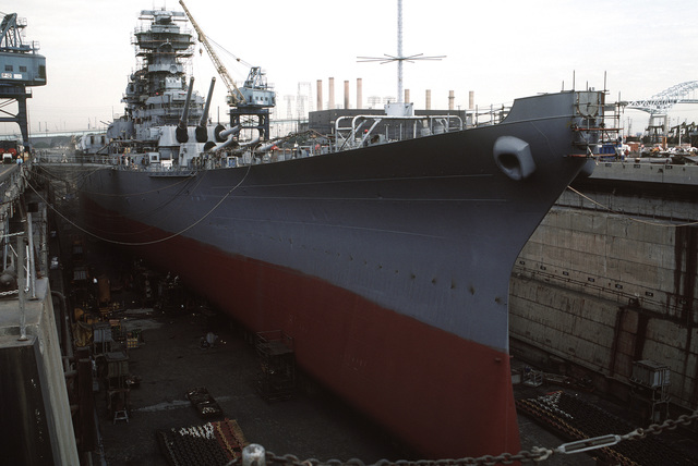 A starboard bow view of the battleship NEW JERSEY (BB-62), while in dry dock undergoing refitting and reactivation