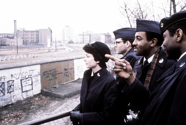 During a tour, United States Air Forces in Europe Outstanding Airmen of the Year look over the Berlin Wall into East Berlin