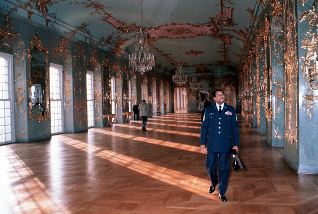 United States Air Forces in Europe SENIOR Non-Commissioned Officer of the Year, SMSGT Melvin E. Mills walks through one of the Charlottenburg Palace ballrooms during a tour