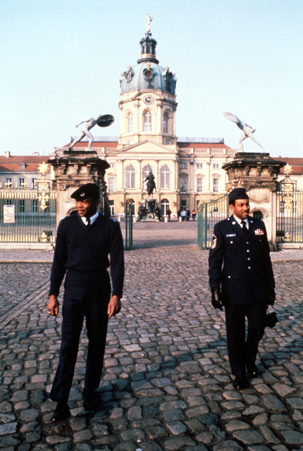 United States Air Forces in Europe SENIOR Non-Commissioned Officer of the Year, SMSGT Melvin E. Mills (left), and Non-Commissioned Officer of the Year MSGT Van A. Sanders tour Charlottenburg Palace