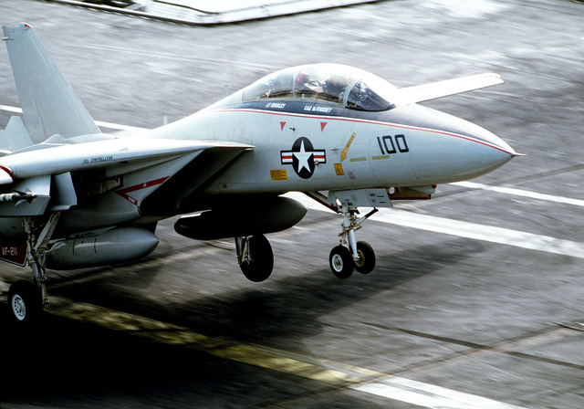 An F-14 Tomcat aircraft from Fighter Squadron 211 (VF-211) lands aboard the aircraft carrier USS CONSTELLATION (CV-64) during flight demonstrations