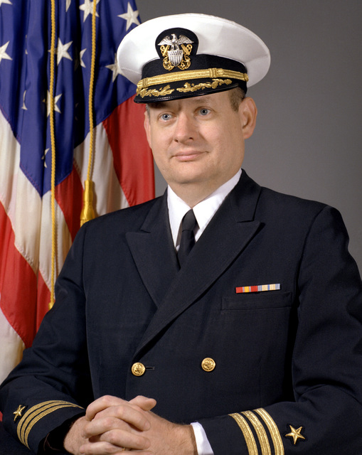 CDR Thomas W. Dennison, USN (covered)