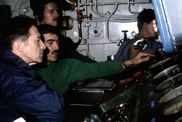 Secretary of Defense Caspar Weinberger talks to crewmen as he tours the aircraft carrier USS CONSTELLATION (CV-64) during a visit