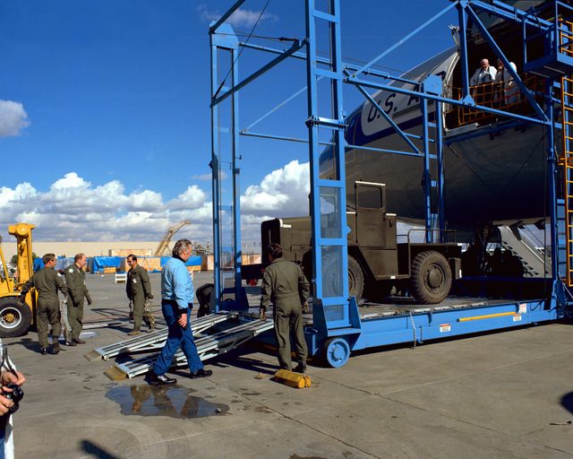 A cargo loading demonstration is given beside a KC-10A Extender aircraft