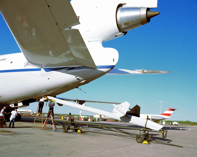 A side view of the extended refueling boom of a parked KC-10A Extender aircraft during the tests on the support equipment of the aircraft