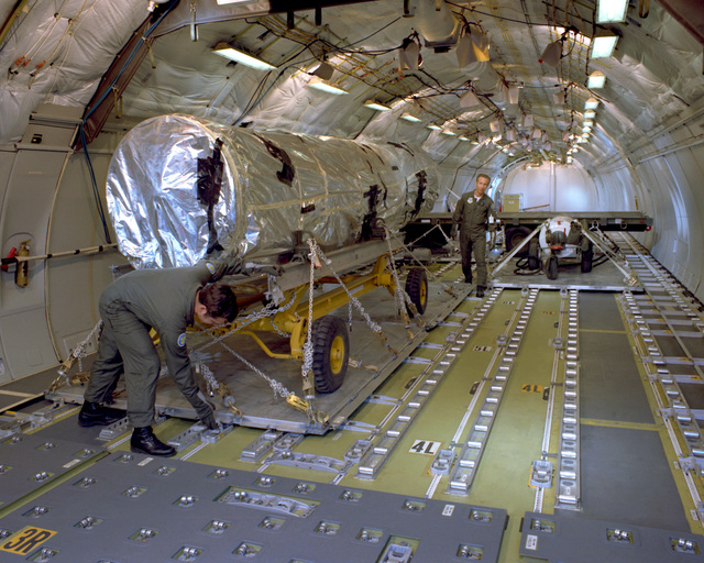 Cargo is secured aboard a KC-10A Extender aircraft during a loading demonstration