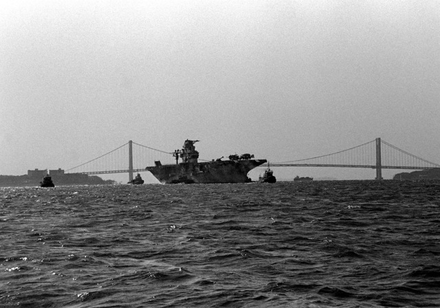 A starboard bow view of the anti-submarine warfare support aircraft carrier ex-USS INTREPID (CVS-11) being towed by tug boats. The INTREPID is being towed to Bayonne, N.J., to be refitted and transformed into a museum