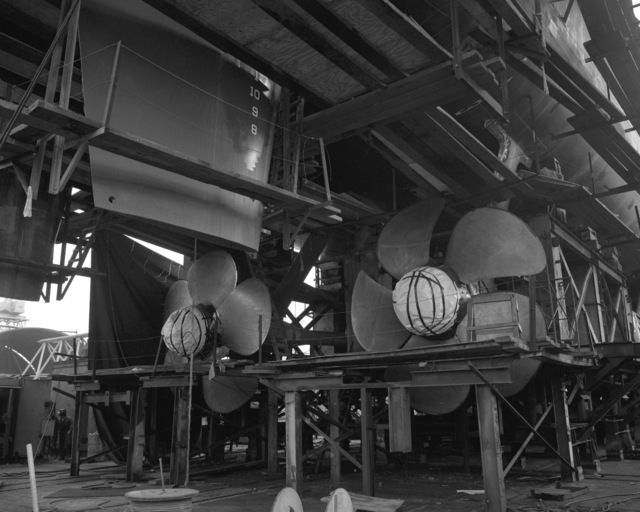 A stern view showing propellers and rudders of the destroyer HAYLER (DD-997) at 60 percent completion