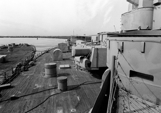 A view from the O2 deck looking aft along the starboard side of the IOWA (BB-61). The ship is in mothball storage here