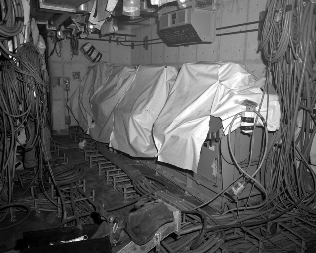 A view of the combat information center aboard the destroyer HAYLER (DD-997) at 60 percent completion