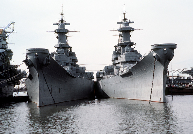 Bow view of the battleships IOWA (BB-61), on right, and WISCONSIN (BB-64). Both ships are in mothball storage here and are slated to be returned to active service