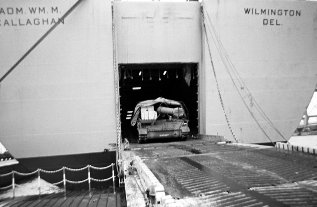 A self-propelled howitzer is off loaded from the vehicle cargo ship USNS CALLAGHAN (T-AKR 1001)