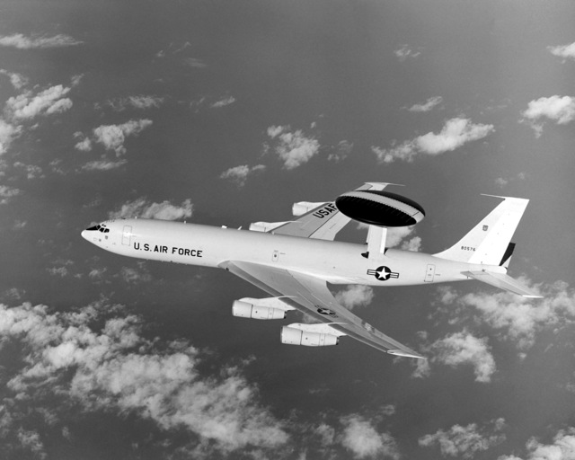 An air-to-air left side view of an E-3A Sentry aircraft, one of many aircraft that flew in support of Operation Kangaroo '81