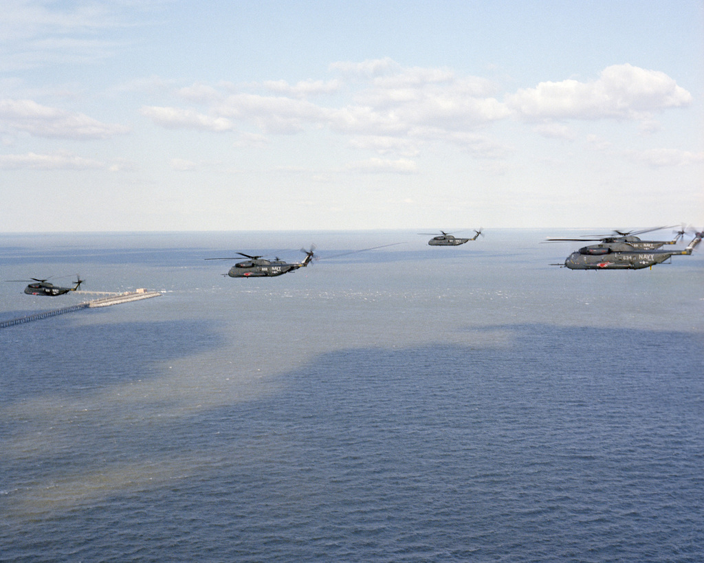 An air to air left side view of Helicopter Mine Countermeasures Squadron 12 (HM-12) RH-53D Sea Stallion helicopters in formation