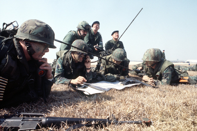 Defender forces from the 51st Security Police Squadron set a field command center on the flight line median during Exercise Team Spirit '82