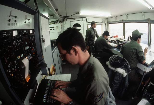 Interior view of the air traffic control tower. The men are participating in Exercise Team Spirit '82