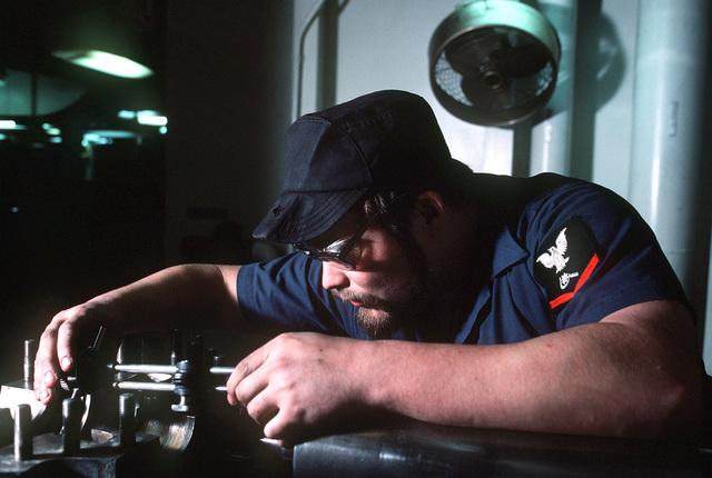 Machinery Repairman 3rd Class Stephen Hack takes a valve measurement with a dial indictor. Hack is a crewman aboard the destroyer tender USS PUGET SOUND (AD-38), 6th Fleet flagship