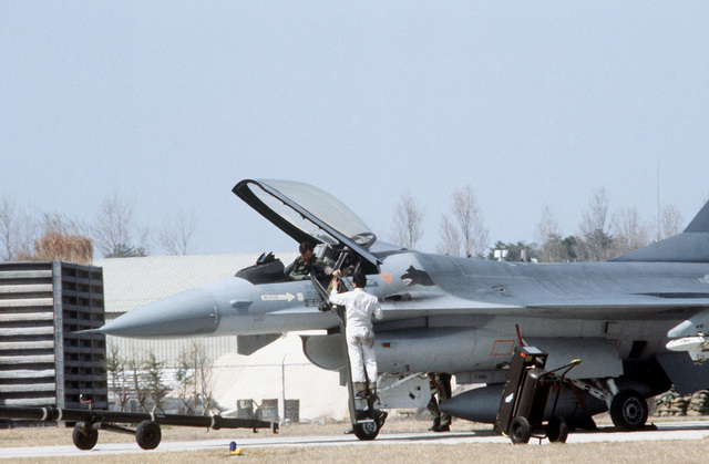 Preflight maintenance is performed on an F-16 Fighting Falcon aircraft during Exercise Team Spirit '82