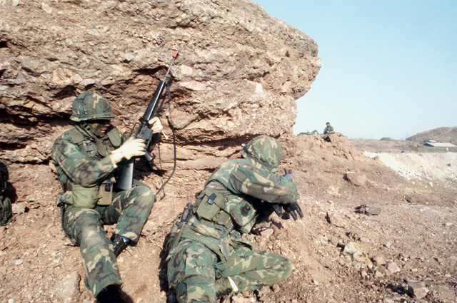 Soldiers defend the boundaries of the air field from aggressor forces during exercise Team Spirit '82