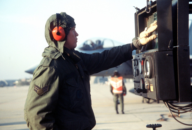 SRA John McKullit operates the fuel gauges used for a hot-pit refueling of an F-15 Eagle aircraft during Exercise Team Spirit '82