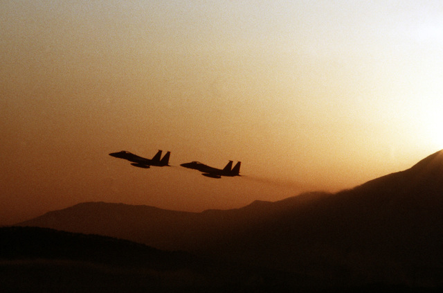 Two F-15 Eagle aircraft from the 18th Tactical Fighter Wing take off for a sunrise sortie during Exercise Team Spirit '82